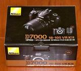 Selling Nikon D7000 16.2MP DSLR Camera & 18-105mm VR Lens 32GB Deluxe Kit